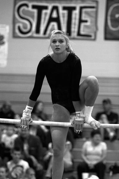 Freshmen Haley Johnson completes her bar routine at the Free State invitational