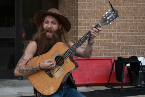 Tyler Gregory, a street musician at the 2013 Busker Festival.