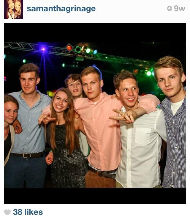 German teenagers surround Samantha Grinage.