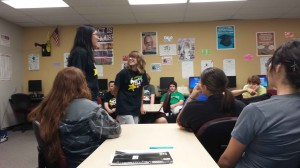 President Sophie Divney (11) runs an idea by Vice President Celine Nguyen (11) before presenting it to the club.