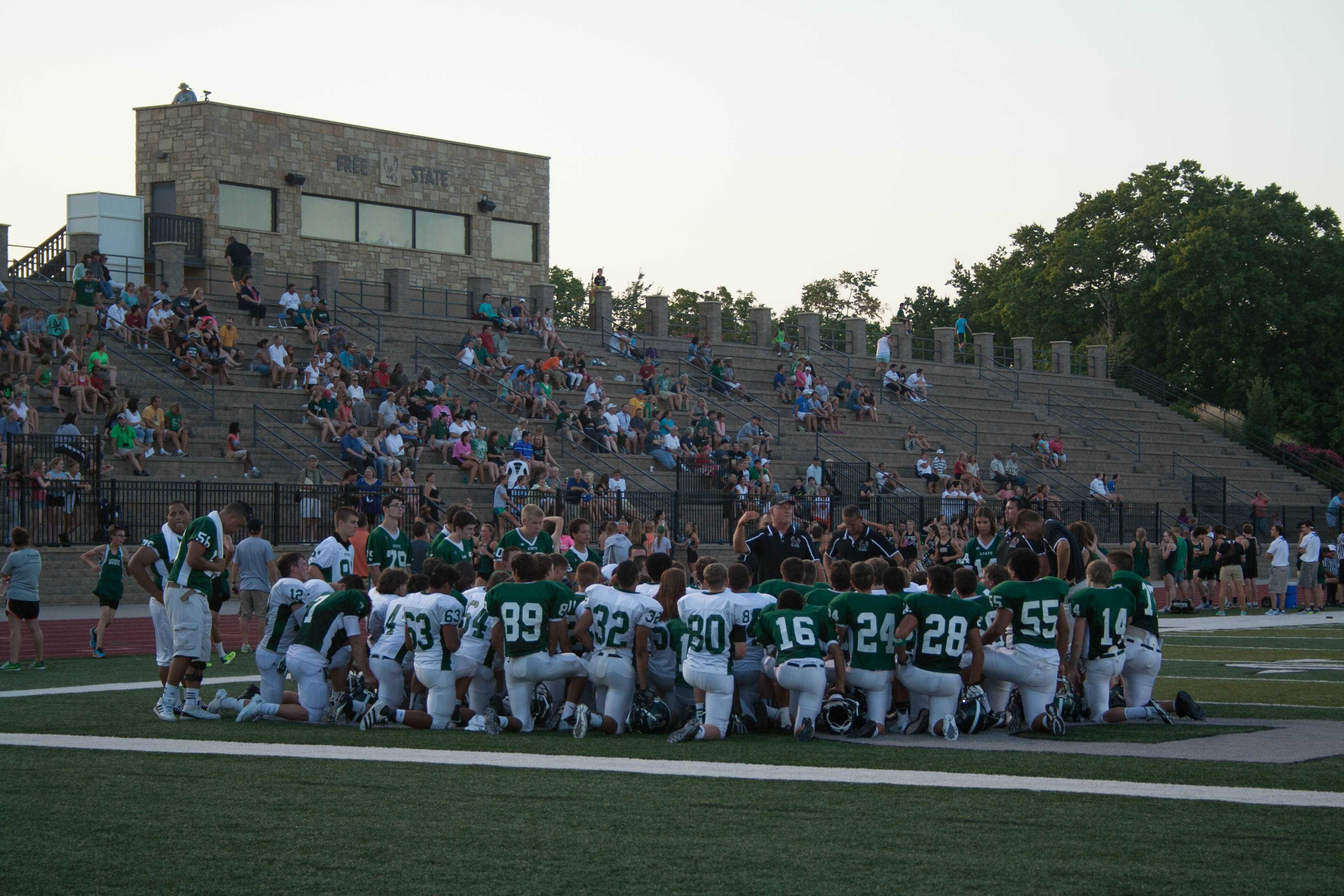 A+stadium+full+of+fans+gets+excited+as+the+football+team+prepares+to+scrimmage.