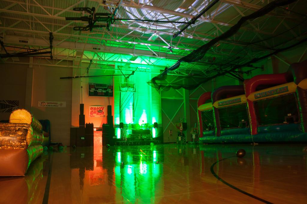 A green light illuminates the small gym before the Homecoming dance begins.