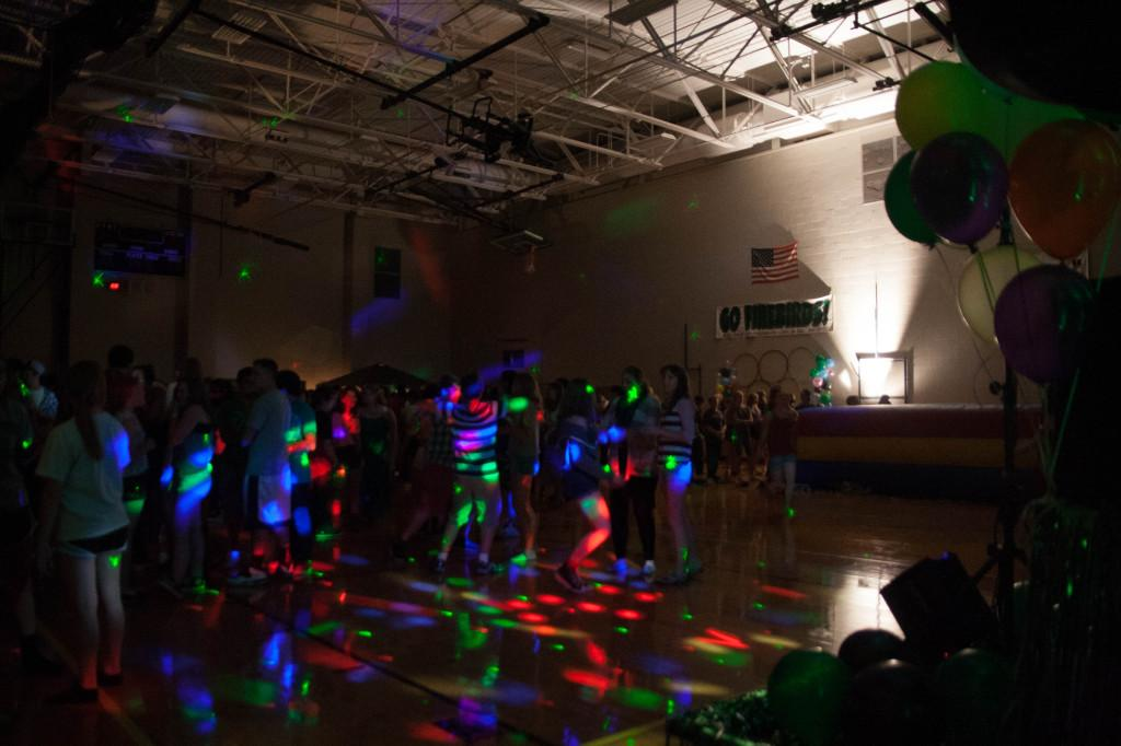 A cluster of students blur into a mass of excitement and fun during the Homecoming dance.