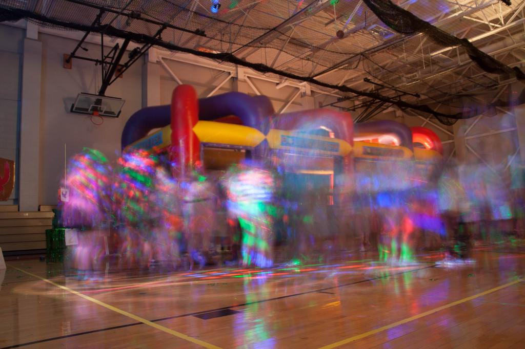Colorful lights brighten the small gym during the Homecoming Dance.