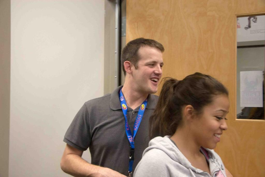 New debate coach Jason Moore smiles as he holds open the door for junior Lexci Kimball. He was hired three weeks into the season after the departure of Patty Newkirk.