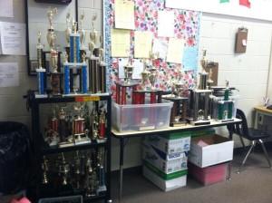 Debate coach gives away older trophies