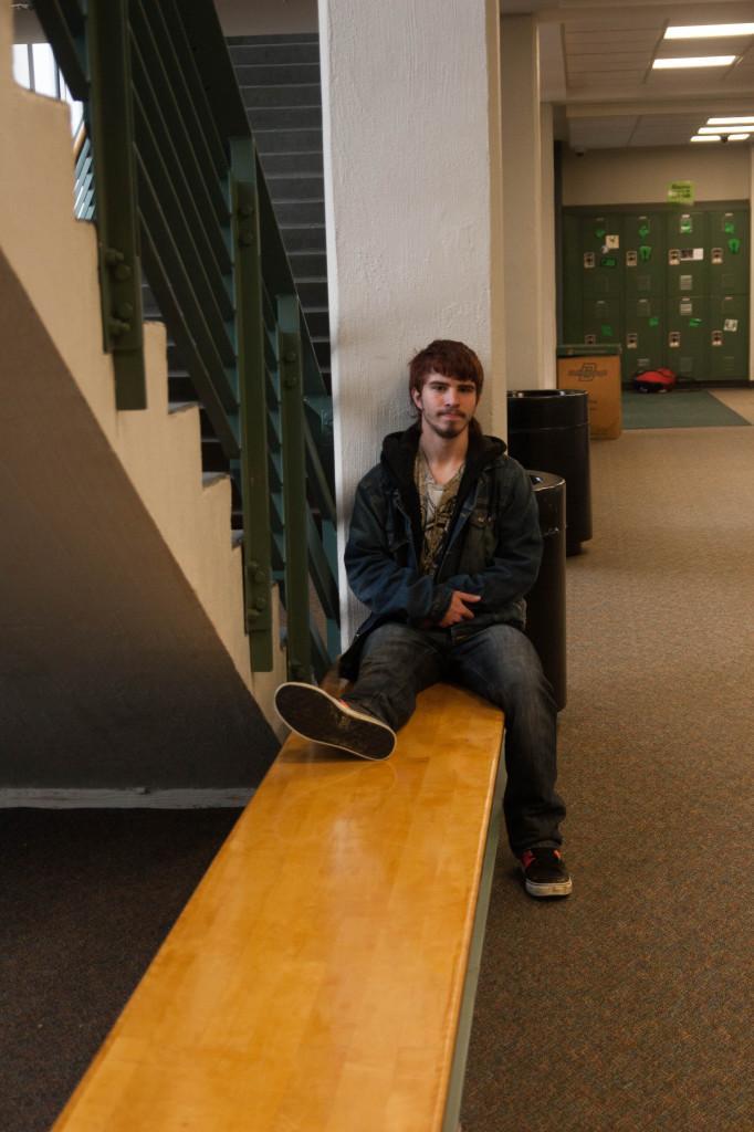 Junior Austin Welborn sits in the back hallway.