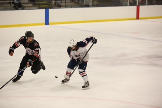 Junior Anthony Hummel, on right, squares off against an opponent during a Midwest High School Hockey League game in 2013. Hummel is one of the four student hockey players the Free Press found.