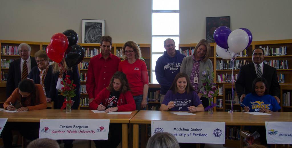 Alexa Harmon-Thomas, Jessica Ferguson, Maddie Dieker and Olivia Hodison sign their letters of intent.