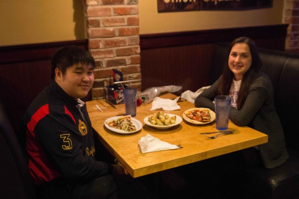 Juniors Parkin Srisutiva and Isabelle Haake sit down to dinner at Johnny Bruscos Pizza.