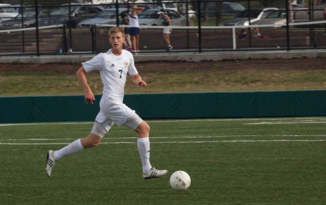 Senior Chris Allen chases down the ball at a game against Shawnee Mission East. Allen recently committed to play soccer at the Richmond International Academic and Soccer Academy (RIASA) in Leeds, England.