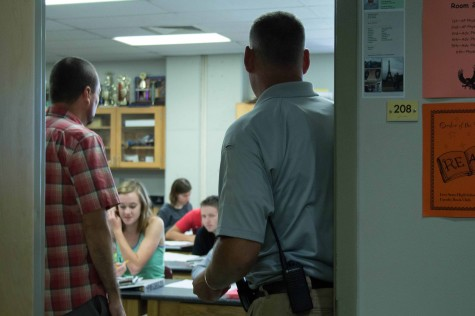 SRO Ty Scheibler goes into a science classroom to observe.