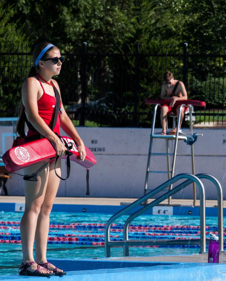 Senior Elyse Boxberger perches at her post as a lifeguard at the Lawrence Outdoor Pool.