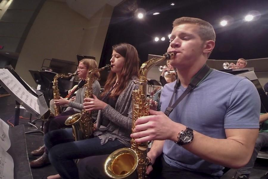 (From right) Senior AJ Zarnoweic and juniors Sydney Gard and Christina Craig play their saxophones. This year, Dr. Albert Miller took over as the new jazz band director.