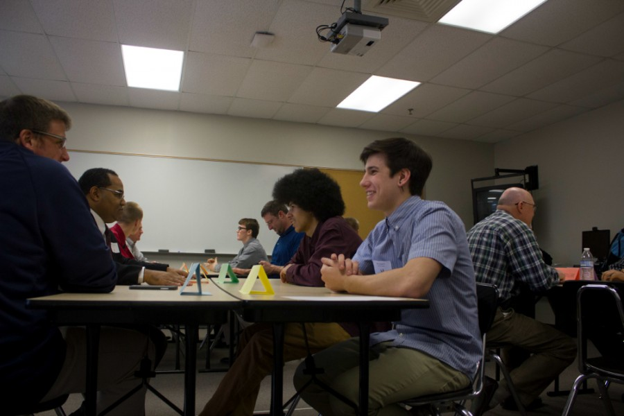 Junior Donovan Young and sophomore Arlo March, students selected to be in the Ambassador Program, get to know their business partners before the start of the programss second meeting. The students were selected based on counselor recommendations.