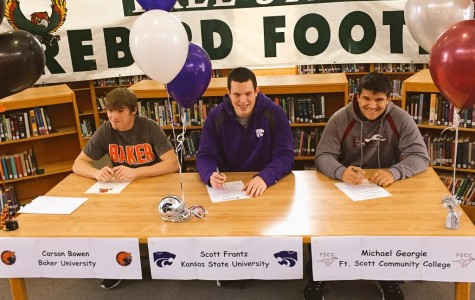 Seniors Carson Bowen, Scott Frantz and Michael Georgie sign to play sports at their college of choice. Bowen, Frantz and Georgie were all players for Free State's football team.