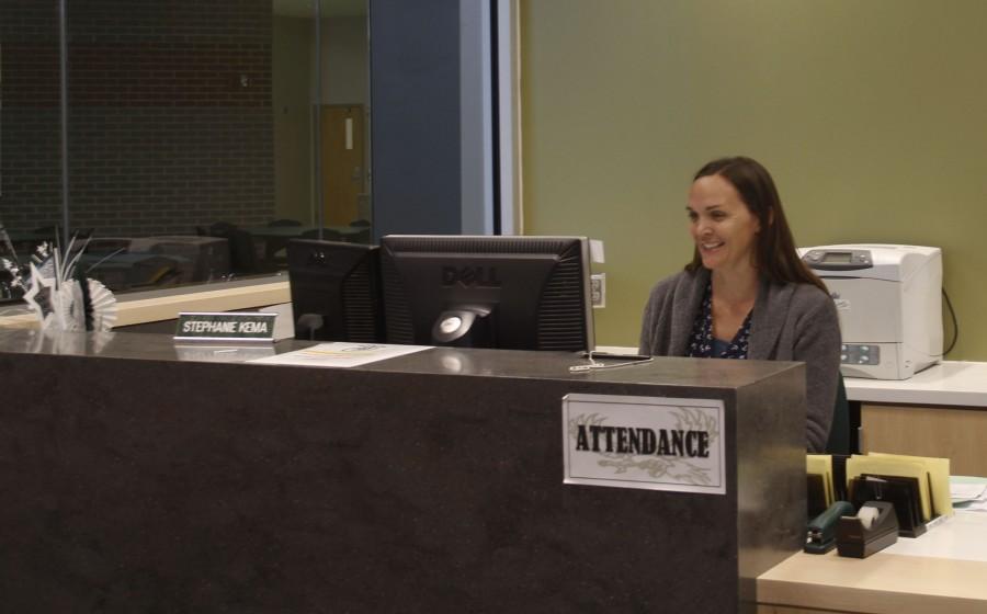 Attendance Secretary Stephanie Kema at her desk.