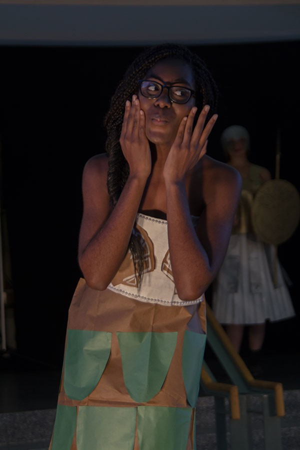 Co-online editor Maame Britwum pretends to be a fish on the Brown Bag Fashion show runway. This was Britwum's first time being a model for the show.