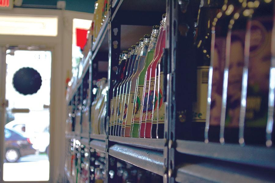 Bottles of soda are highlighted by the afternoon sun at Mass Street Soda on 1330 Mass Street. 1,300 varieties of craft soda are displayed on their shelves.