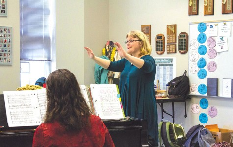 During Concert Chorale, Hilary Morton conducts her students as they sing