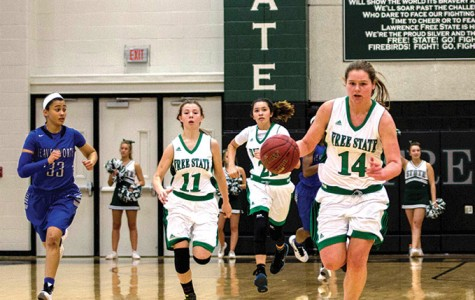 Two girls basketball players reach 1,000 points