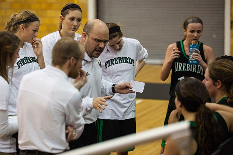 Coach Duncan calls a timeout during an away game. This is Duncan's last year of coaching for the girls basketball team.