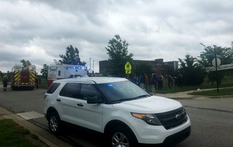 A Lawrence Police Department vehicle parked near the scene of the incident. Students were alarmed by the sudden presence of emergency services during their lunch period.