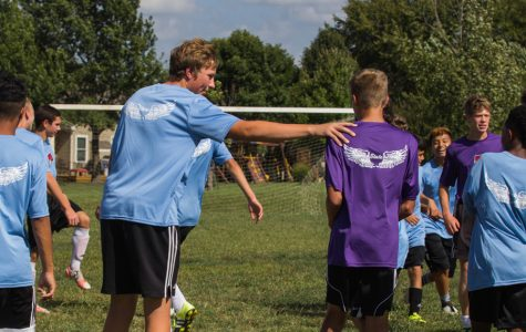 Sophomore Bayn Schrader consults his teammate Jacob Appleman during a drill. All soccer players started conditioning only two weeks after school ended in May.