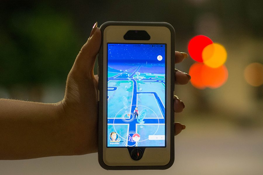 """Pokemon GO players plan trips downtown to catch pocket monsters and battle other trainers. """"There were groups of fifty people at each intersection at 3 a.m. after the bars let out, Frager said."""