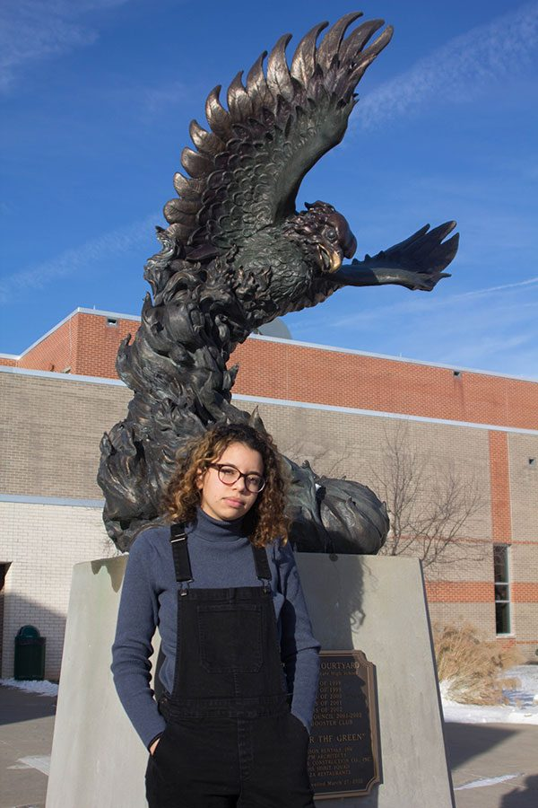 Standing in front of Freddy the Firebird for the last time, Brittany Swearingen says goodbye to Free State at semester, making the decision to complete her high school education through the Lawrence Virtual School.