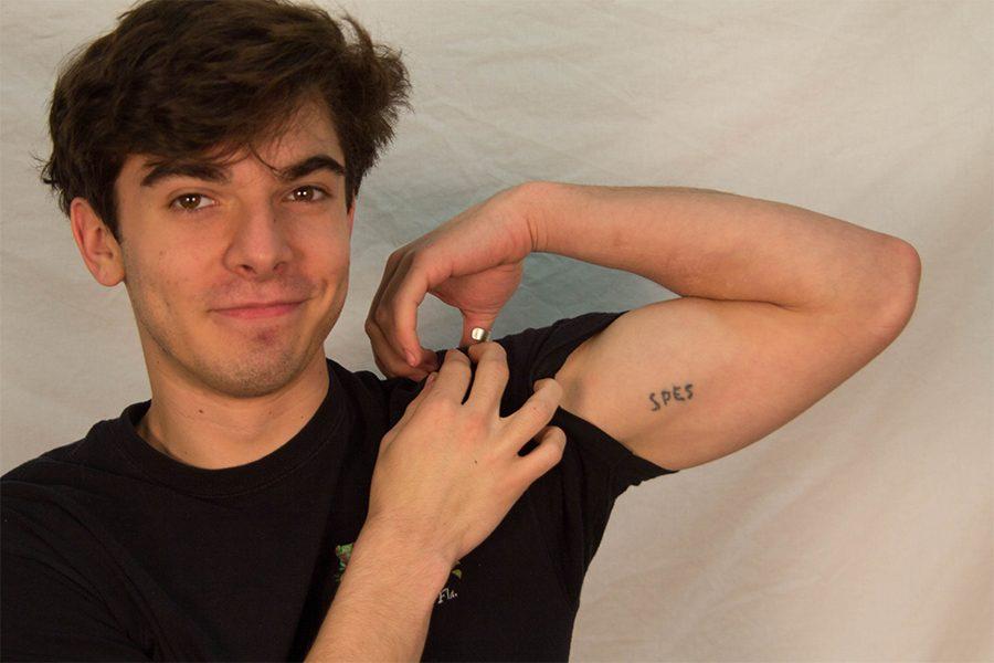 Dorian Vance displays his tattoo.