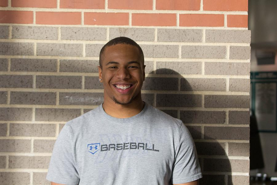 Happy from the recent news, Bowlin smiles in the commons. Bowlin has played Baseball since his freshman year.