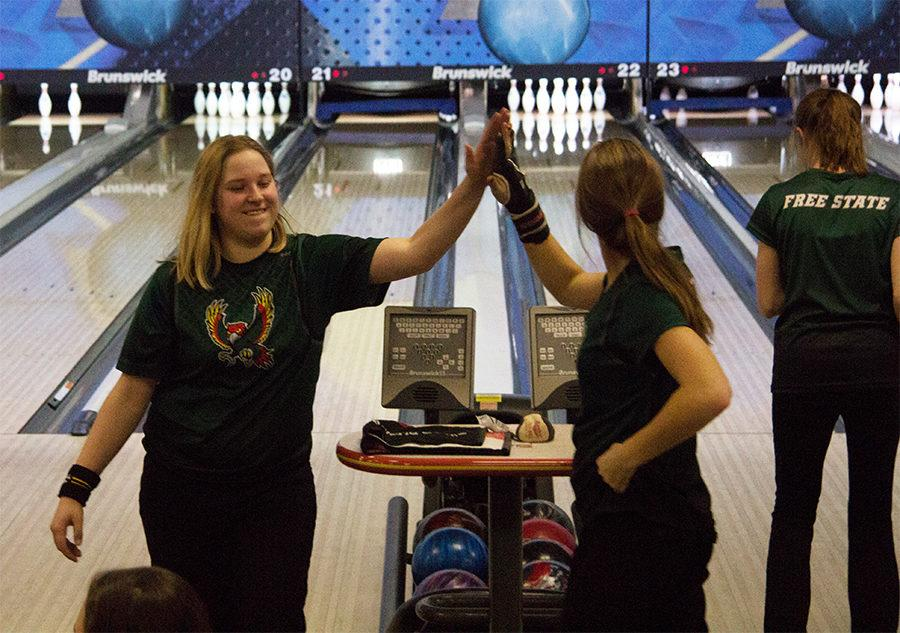 High+fiving+her+teammate%2C+Sapphira+Knight+celebrates+after+bowling+a+strike.+Knight+is+on+the+girl%E2%80%99s+varsity+bowling+team+this+year+and+has+been+bowling+through+Free+State+for+three+years+now.+%E2%80%9CI+think+meeting+new+people+%5Bis+my+favorite+part+about%5D+each+tournament+we+go+to.+There%E2%80%99s+like+six+people+on+each+team%2C+so+you+get+to+meet+six+new+people+you+bowl+with%2C%E2%80%9D+Knight+said.