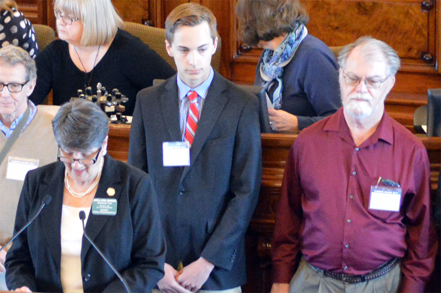 Junior Adam Ziegler and anthropologist Donald Blakeslee are recognized in front of the Kansas House of Representatives. The site near Arkansas City was recently recognized by the state.