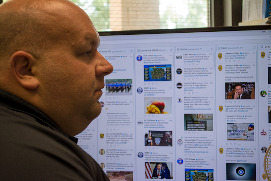 Finnelly keeps an eye on the @LawrenceKS_PD twitter feed while working. The account had over 35,000 followers.