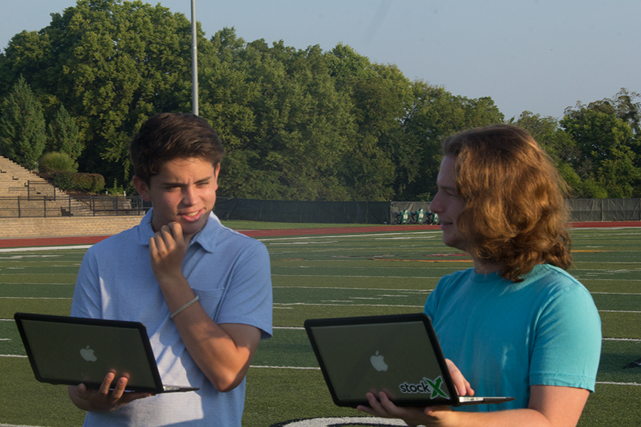 Will Cook and Evan Cornell contemplate their draft picks. The NFL season begins Thursday, Sept. 7.