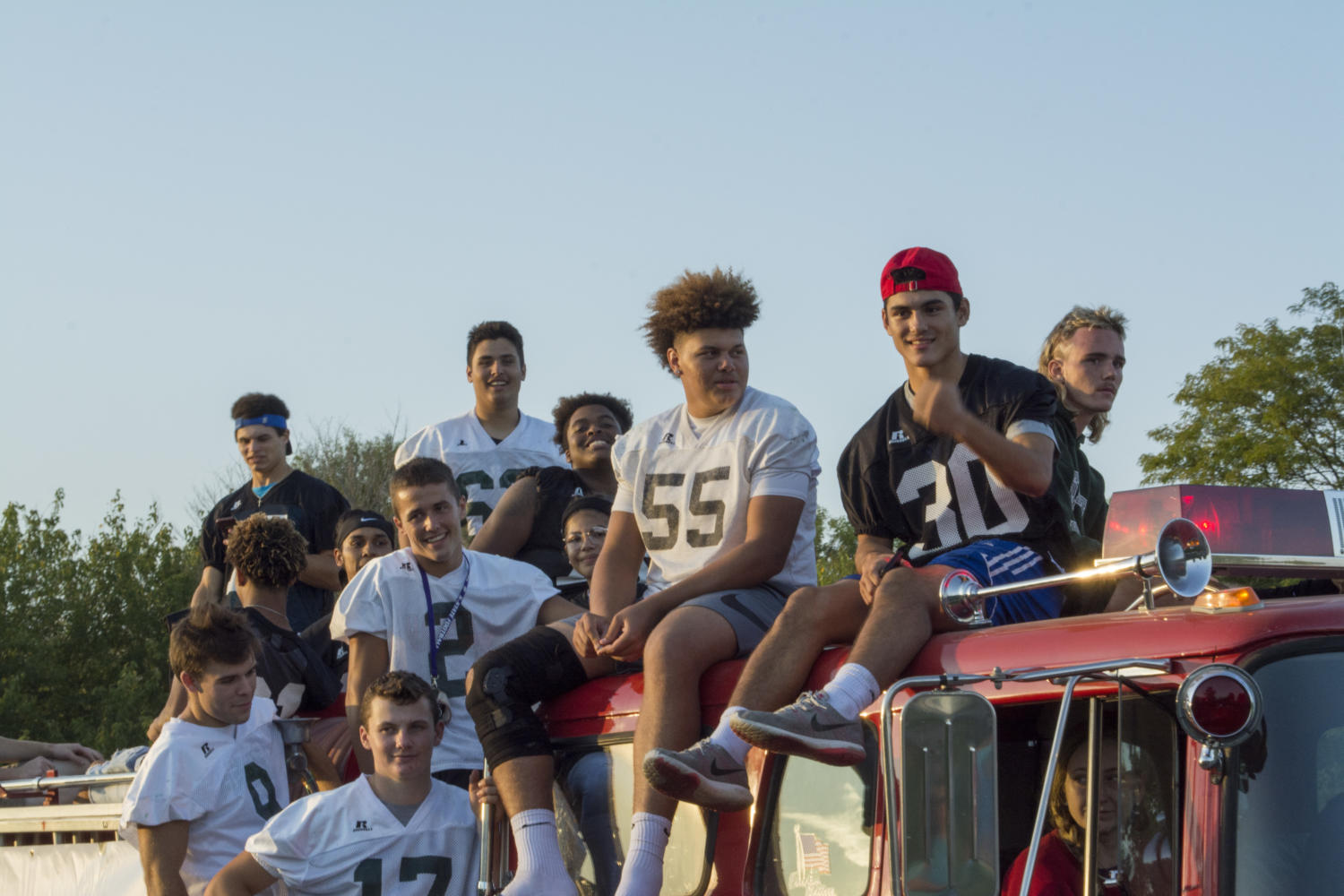 Senior football players Gage Foster, Gabe Del Valle, Gabe Clark, Jalan Robinson, Taylor Royal, Caden Johnson, Tanner Cobb, Jake Rittman, and Bo Miller ride the senior football float. The float was a decommissioned firetruck with a working horn and siren.