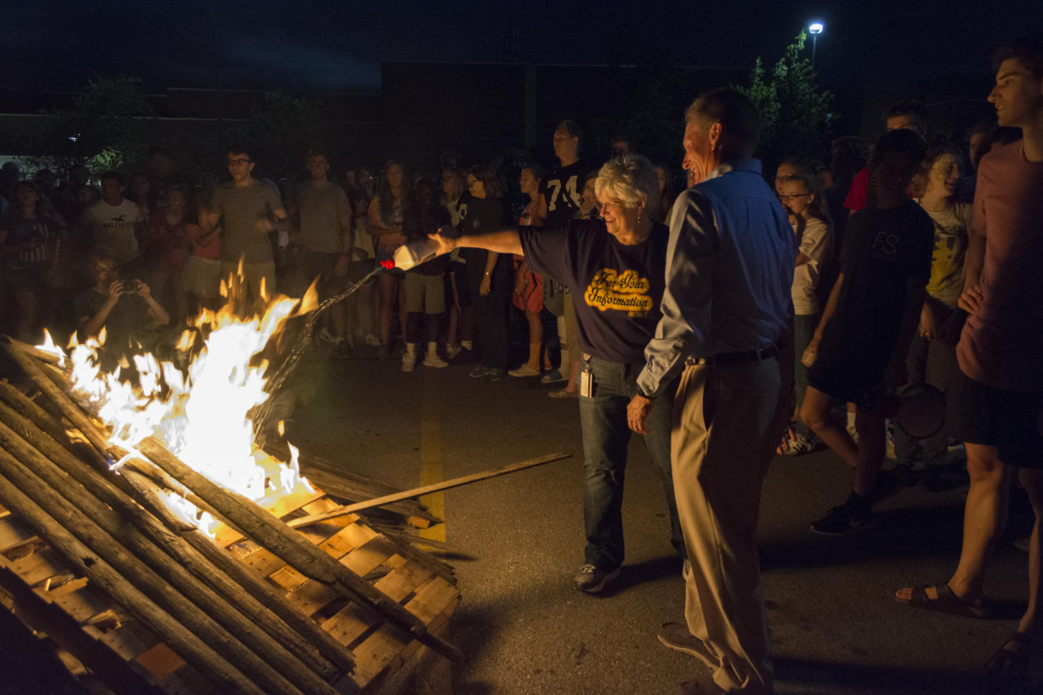 Librarian Leslie Campbell and principal Myron Graber attempt the light the bonfire. The fire wouldn't stay lit Monday night.