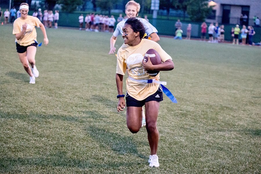 In the process of completing her forth touchdown of the night, Hodison takes the ball down field. Hodison scored a majority of the seniors touchdowns leading them to victory against the sophomores.