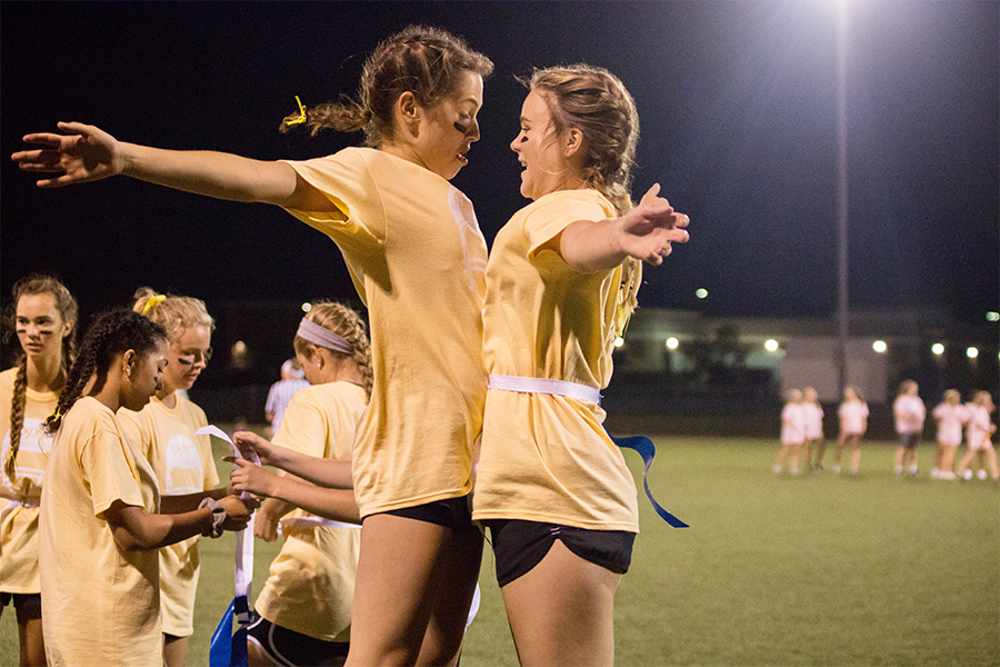 Celebrating a win against the sophomore team, seniors Maggie Ziegler and Grace Patchen chest bump. The seniors fell short one point to the juniors in the championship.
