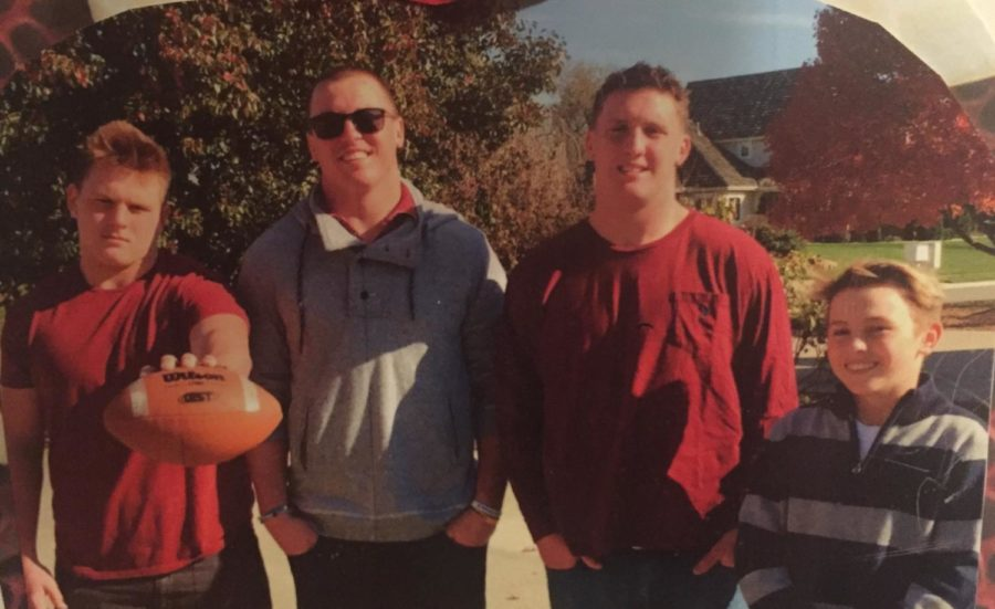 Jax, Joe, Jay and Jet Dineen pose for a family photo. Jax Dineen is a junior who plays running back for the firebirds
