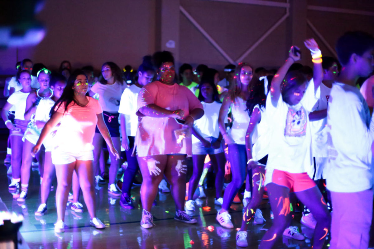 Dancing+to+the+Cha+Cha+Slide%2C+students+filled+the+gym+for+a+thrilling+bookend+to+Homecoming+week.