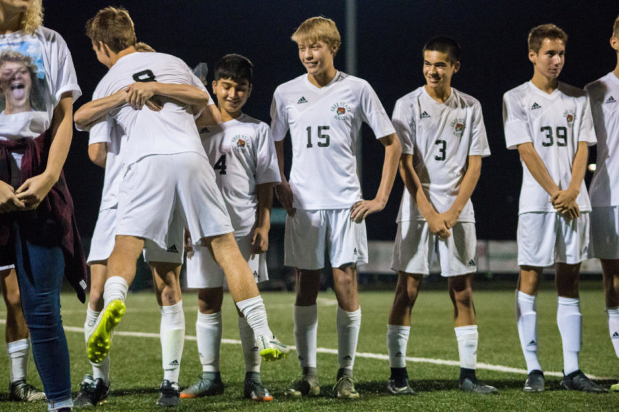 Senior Nick Howard gets recognized and hugged by every member of his team. The seniors were congratulated on all their hard work throughout the season.