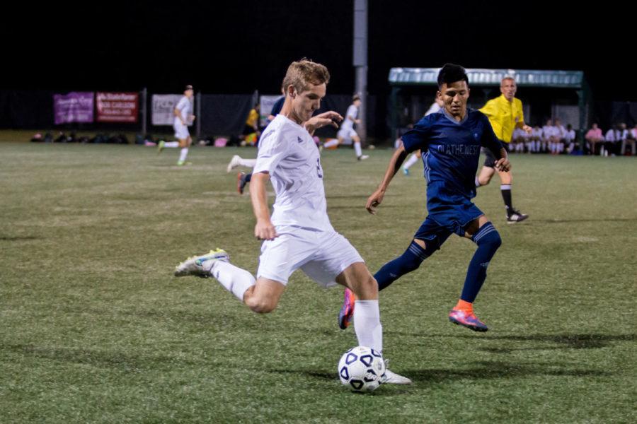 With determination, senior Nick Howard kicks the ball down field. The firebirds won 3-0 against Olathe West.