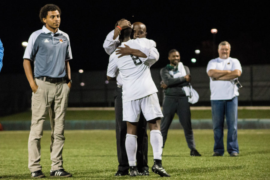After being recognized by his team members, senior Mburu Nganga gets hugged by Coach Barah. Barah gave each senior a hug.