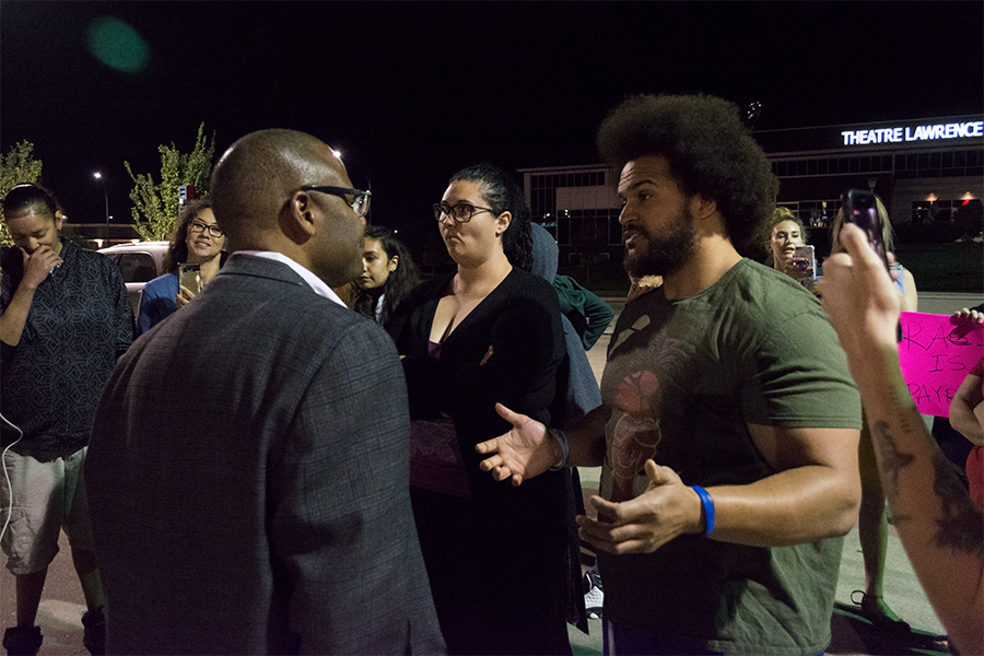 Prominent Black Lives Matter Lawrence member Caleb Stephens argues with area director Anthony Robinson.