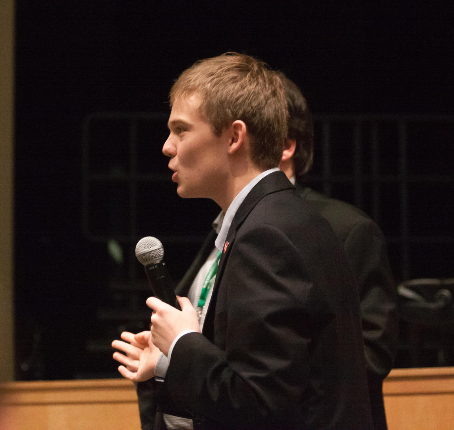 Tyler Ruzich adresses an audience member while answering a question. Ruzich describes himself as a Republican because his parents were able to go to college without government assistance.