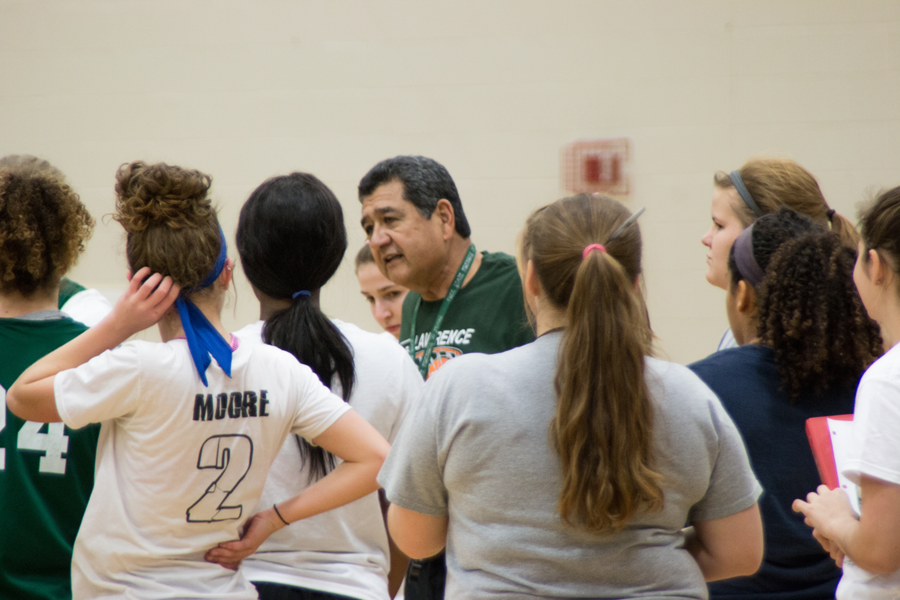 At girls basketball tryouts on November 14 the head coach, Ted Juneau talks to the girls. This year the varsity team only has one senior player.