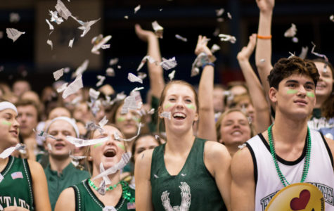 After tip off, the firebird student section throws teared up news papers into the air.