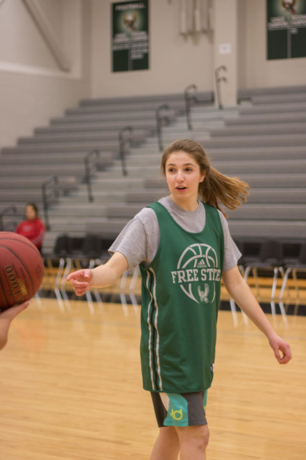 Erin Cushing receives a pass during practice.